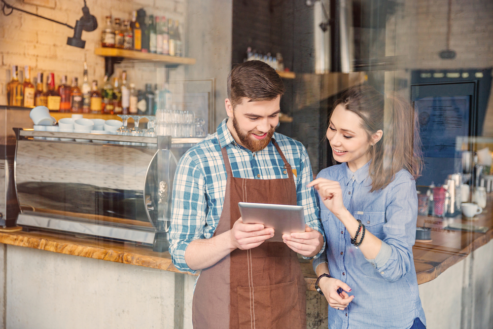 Restaurant owners looking at the best finance apps