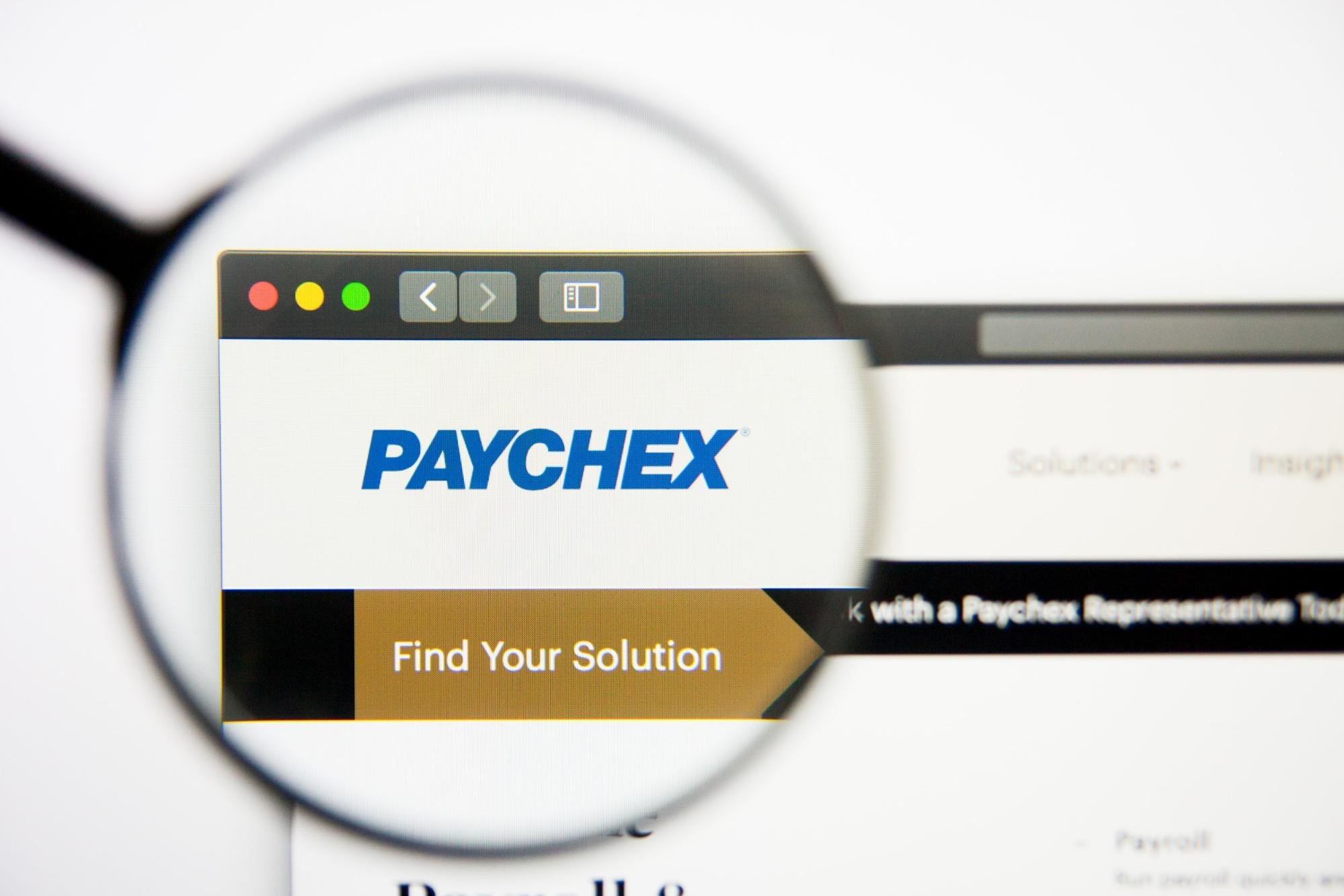 Magnifying glass over Paychex website