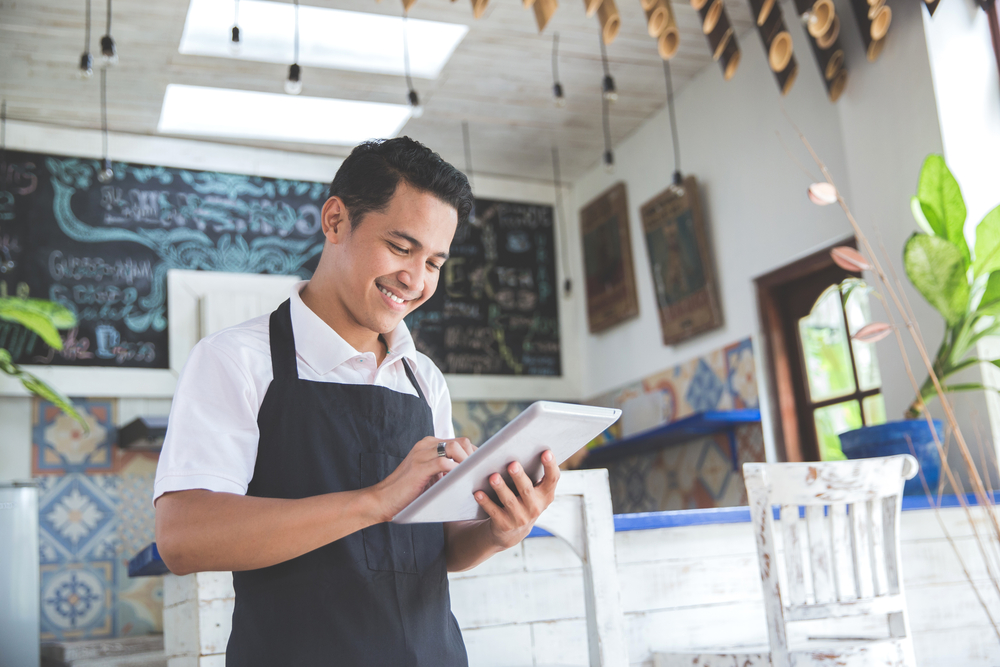retail business owner using helcim on tablet