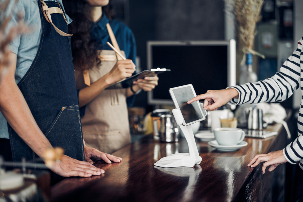 business accepting digital payment on tablet with adyen payment