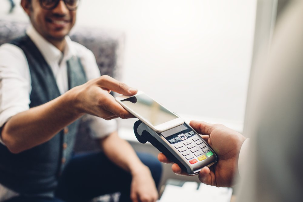 business accepting contactless mobile payment with adyen